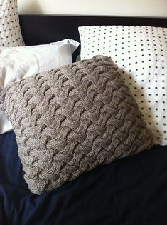 Ravelry: Chunky Cable Knit Braided Pillow pattern by Catalina Miguel.  Yera Moda yarn from Spotlight held dbl.  50g ball of 70% viscose derived from bamboo and 30% cotton [Sport]