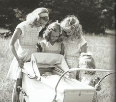 B. The sisters watch the baby in awe as they've got their first and only male sibling - Prince Carl Gustaf.