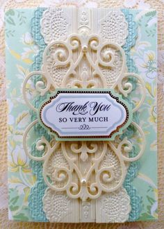 Card by Vickie Blakeslee. Anna Griffin Garden kit card used with Metallic Layers Papers and lace impressions dies and border embossing. Flourish die also used. https://www.pinterest.com/dvblakes2/vickies-anna-griffin-card-creations/