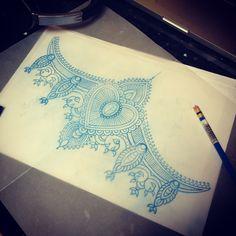 under breast mandala tattoo