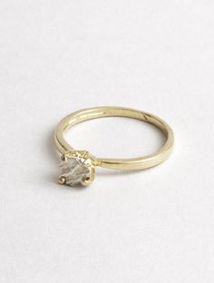 1.5mm band. Rock is 4mm. 14k yellow gold band with 14k white gold rock.