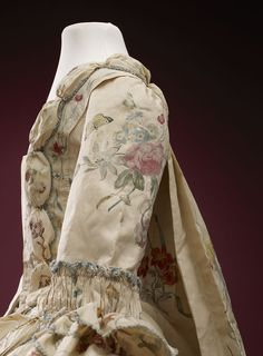 Detail side view, robe à la francaise, 1740-1760. Cream silk, beautifully hand-painted with floral motifs, flower sprays, birds and insects; self-fabric trimming, linen lining.