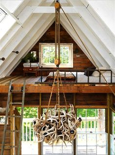 The new tree house features two sleeping platforms and a DIY antler chandelier.