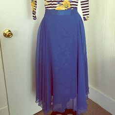 Blue Vintage Midi Skirt Very fun skirt! The tag is old, I'm not sure of the brand. 100% polyester and dry clean only. The tag says it's a 5/6. Follow me on Instagram: @vicariouskatie Unknown Skirts A-Line or Full