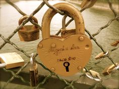 Love Locks .... <3 Place an engraved love on a bridge and throw the key over the edge...
