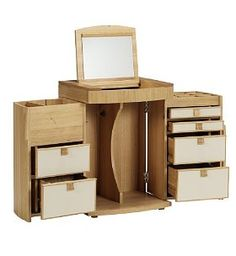 Crafted predominantly from solid oak and oak veneer. This compact dressing table combines style and function. Both doors open fully to reveal 6 drawers with an additional deeper compartment for larger products. The lid lifts to reveal a mirror and storage compartments for all your smaller accessories.