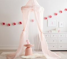 Pink tulle canopy for girls - Dreamy grey and pink peony nursery with swan decor • Girls floral nursery • Swan nusery • Pink peony nursery with gray rocking glider, silver tufted crib, pink flower wall decals, tulle canopy and swan decor Chandeliers and Champagne