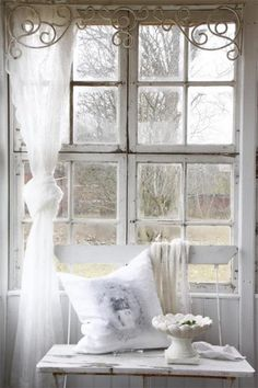 Love the old scrollwork above the window!!