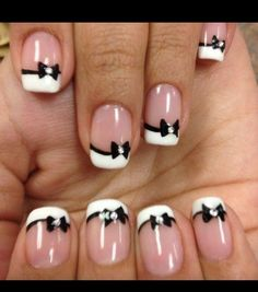 French manicure with black bows and diamond