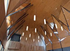 Based on an inspiration of abstracted trees, this installation was comprimised of 10 large planar trees that soared 30+ feet to create a canopy within the architecture of the Colombier Jesuit Center chapel. Crafted of patinated blackened steel and perforated wood, the panels also provided acoustical benefits to the space.
