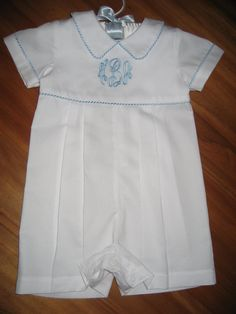 Idea for George's christening outfit...make it in winter white featherwale corduroy with ice blue whipstich trim and monogram...adorable!