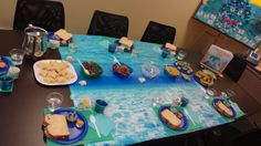 Gather some of your favorite water themed treats along with a ocean printed bulletin board paper/butcher paper, colorful plates and silverware to turn those pout-pout faces into a smile! #deborahdiesen #poutpoutfish #bookit #books #kidslit #reading #party