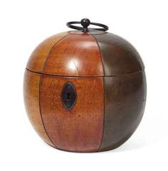 A GEORGE III STAINED-WOOD MELON-SHAPED TEA CADDY CIRCA 1800 With green, brown, yellow and red segments, iron handle and escutcheon