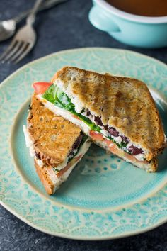 Close up of low FODMAP Mediterranean grilled cheese on a blue plate