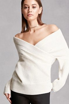 A midweight wool-blend ribbed knit sweater featuring a draped surplice neckline, long dolman sleeves, an a thick ribbed hem. This is an independent brand and not a Forever 21 branded item.