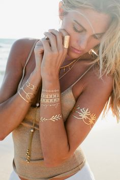 Love flash tattoos for summer. Pick out striking black or red swimsuit to compliment metallics. http://thejesssettersguide.com/2015/03/02/flash-tattoos/