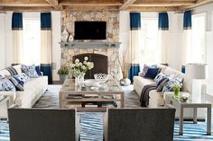 Muse interiors color block drapes drapery curtains blue gray off white living room stone fireplace dueling facing sofas exposed beam ceilings