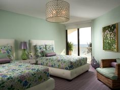 Tropical Relief  Guests at this beach house are treated to custom white headboards and tropical bedding. The headboard's tufts mirror the pattern in the overhead light. Designer: Joseph Pubillones
