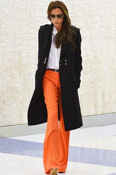 Victoria Beckham - this is a good look in the field. You don't need to wear the extreme heals, but a nice tailored jacket for cold weather is a must.