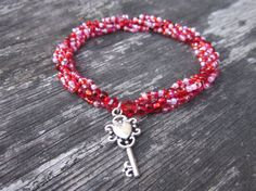 Spiral Beaded Bracelet (petite w/ Valentine's Day bead mix and heart key charm)