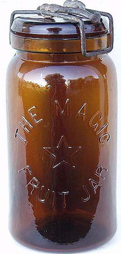 THE MAGIC / {star logo} / FRUIT JAR quart jar in root beer amber with original matching lid and 3-piece iron clamp