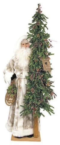 Santa holding snow shoes & tree