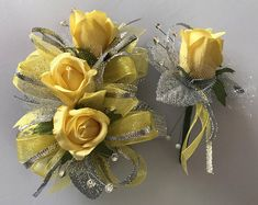 Yellow and silver ribbons, rhinestones, silk roses with matching boutonnière. Corsage and boutonnière are boxed in a crystal clear floral corsage. Corsage has a stretch wristband. Custom orders are welcome. Rose Corsage, Corsage And Boutonniere, Corsage Wedding, Corsages, Boutonnieres, Blue Wedding Dresses, Wedding Flowers, Wedding Stuff, Silk Roses