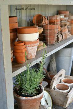 terra-cotta pots in a garden shed