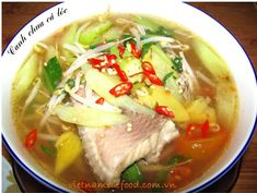 Sour Soup with Snakehead Fish Recipe (Canh Chua Cá Lóc) from http://www.vietnamesefood.com.vn/vietnamese-recipes/vietnamese-soup-recipes/sour-soup-with-snakehead-fish-recipe-canh-chua-ca-loc.html
