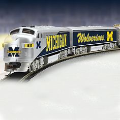 Shop The Bradford Exchange for Go Blue Express Train Collection. The Go Blue™ Express is rumblin' through the heartland and it's proudly sporting the Wolverines™ iconic colors. Bring home this real working electric train collection and you won't miss a. Michigan Go Blue, Michigan Wolverines Football, Hawthorne Village, Electric Train Sets, Sports Team Logos, College Football Teams, Old Trains, Train Pictures, University Of Michigan
