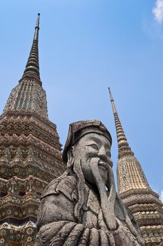 ✮ Wat Pho, Stone guard statue and temple spires - Bangkok, Thailand