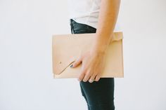    The Laura Clutch    The perfect carry-all for those days when a purse just won't do. The Laura clutch is large enough to hold all of your essentials, from your cell phone, key rings, and day planners, to everything in between.
