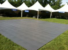 A festival with 12 festival frame tents and event flooring for the dance floor. 844-TENT PRO