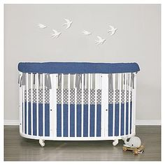 Stokke Sleepi. Bumperless in premium linen. Custom made bedding for the Stokke oval cribs. This one is for the boys.