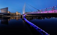 https://flic.kr/p/GuegLF   Neon Dawn   A pre dawn visit to Media City, Salford, perfect calm conditions, and zero degrees temperature made for some great still water ideal for reflecting the neon lights into, not ideal for keeping a warm set of hands! this bridge is a previously shot location at sunset in totally diffrent colours, managed to not get locked in a car park this time too...