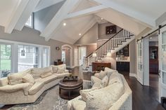 Hellyer Custom Builders new home in Barrington IL - Living Room with Stairs to Master Suite