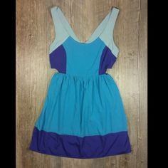 Teal Aqua and purple cut out dress Teal Aqua and purple cut out dress. Cut out sides and back. Small zipper in back. Elastic waist band on side n back. Polyester. Length 33 inches. Tag reads small Roxy Dresses