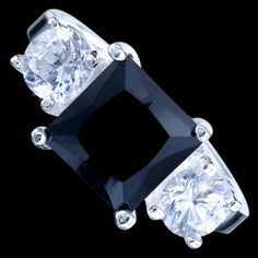 Silver ring, CZ, square Silver ring, Ag 925/1000 - sterling silver. With stones (CZ - cubic zirconia). Striking jewellry made up of central square zircon and two smaller round ones. Dimensions of square zircon approx. 9x9x6mm.