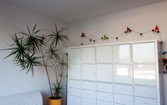 Creative transformation of IKEA dog tail hooks into string lights.