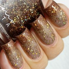 """How's this for a unique thermal? @femme_fatale_cosmetics """"Lion's breath"""" is a nude/tan to brown thermal with a ton of gold holo glitter. 2 coats plus @kbshimmer quick dry topcoat. Available for preorder from @femme_fatale_cosmetics shop on June 1st."""