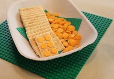 Rectangular crackers and circle cheese for a non-sugary Lego party snack - from Moore Minutes