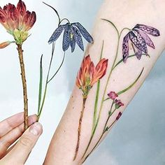 I'm more of an all-black tattoo person, but these incredible tattoos that @rit.kit.tattoo shared are incredible. Floral tattoos are my all-time favorites.