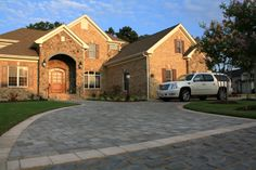 Belgard Mega-Bergerac Driveway YORKTOWN MATERIALS PINTEREST INSPIRATION The timeless, hand-cobbled appearance of Mega-Bergerac® recalls an era when horse-drawn carriages traversed the avenues of Europe's great cities. Its trademark dimpled surface, unique color blends, and a variety of sizes provide you with the ability to create one-of-a-kind works of lasting beauty.
