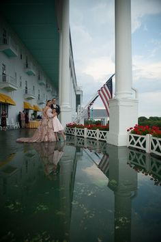 Grand Hotel Mackinac Island porch wedding photo during rainy day by Paul Retherford Wedding Photography, http://www.PaulRetherford.com.  Flowers by Webers Floral #GrandHotelWedding #MackinacIsland #PureMichigan