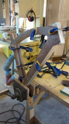 Brown oak bike frame clamped together