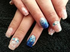 This is an actual pic of my current nails since I didn't think I'd find sumthin that wud look like this on here and I came up with this idea myself for a friends wedding reception to match my outfit :D Love the popular ombré trend and did a frost like white sparkle on the other fingers so the ring fingers really pop! Jewels on middle finger balance the hand since the thumbs are left plain :)