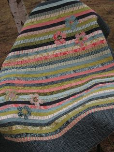 Great design for a jelly roll .  This would be cute for a boy with stars instead of flowers.