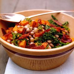 This warm salad combines fall's best flavors and textures. Sweet sauteed squash, bitter broccoli rabe, and smoky bacon are irresistible partners for creamy cranberry beans.