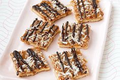 Topped with a caramel, coconut and chocolate drizzle, these shortbread ...