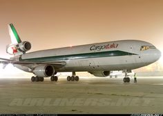 CargoItalia McDonnell-Douglas MD-11F wearing the remnants of its former operator's (Alitalia Cargo) livery